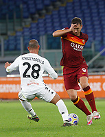 Roma s Edin Dzeko, right, is challenged by Benevento s Pasquale Schiattarella during the Serie A soccer match between Roma and Benevento at Rome's Olympic Stadium, October 18, 2020.<br /> UPDATE IMAGES PRESS/Riccardo De Luca