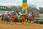 Junebugred and Jockey Joe Bravo (right) win the 5th running of the Smarty Jones with a photo finish over Reckless Jerry (center)  Monday afternoon at Oaklawn Park in Hot Springs, Arkansas.