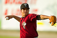 Savannah Sand Gnats starting pitcher Julian Hilario (30) warms up in the outfield prior to the game against the Kannapolis Intimidators at CMC-Northeast Stadium on August 22, 2013 in Kannapolis, North Carolina.  The Intimidators defeated the Sand Gnats 1-0.  (Brian Westerholt/Four Seam Images)