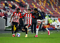 7th November 2020; Brentford Community Stadium, London, England; English Football League Championship Football, Brentford FC versus Middlesbrough; Djed Spence of Middlesbrough challenges Mathias Jensen of Brentford