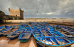 Essaouira (from Berber Tassort, English pronunciation: /??s??w??r?/; Arabic: ????????) is a touristic and windy city in the western Moroccan economic region of Marrakech-Tensift-Al Haouz, on the Atlantic coast. Since the 16th century, the city has also been known by its Portuguese name of Mogador or Mogadore. The Berber name means the wall, a reference to the fortress walls that originally enclosed the city..Morocco (/m??r?ko?/; Arabic al-Ma?rib; officially the Kingdom of Morocco, al-Mamlakah al-Ma?ribiyya), is a country located in North Africa. It has a population of nearly 33 million and an area of 710,850 km?, and also primarily administrates the disputed region of the Western Sahara..Morocco is a de jure constitutional monarchy with an elected parliament. The King of Morocco holds vast executive powers, including dissolving parliament at will