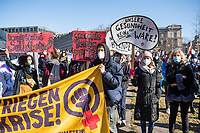 """Protest in Berlin am Internationalen Frauentag unter dem Motto """"Walk-of-Care - Wir kriegen die Krise!"""".<br /> Mehrere hundert Menschen versammelten sich am Montag den 8. Maerz 2021 in Berlin vor dem Arbeitsministerium zu einer Protestkundgebung von Pflegekraeften.<br /> Aufgerufen zu der Kundgebung hatten u.a. der """"feministische Streik Berlin"""", das """"Frauen*streikkomitee Wedding"""", """"Brot & Rosen"""", """"Feminist* Dialogues"""" und das """"Berliner Buendnis fuer Gesundheit statt Profite"""".<br /> In Berlin ist der Internationale Frauentag ein Feiertag.<br /> 8.3.2021, Berlin<br /> Copyright: Christian-Ditsch.de"""