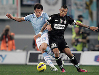 Calcio, semifinale di ritorno di Coppa Italia: Lazio vs Juventus. Roma, stadio Olimpico, 29 gennaio 2013..Lazio midfielder Cristian Ledesma is challenged by Juventus midfielder Arturo Vidal, of Chile, during the Italy Cup football semifinal return leg match between Lazio and Juventus at Rome's Olympic stadium, 29 January 2013..UPDATE IMAGES PRESS/Riccardo De Luca