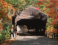 Scenic view of the Albany covered bridge in the White Mountain National Forest; framed by fall foliage. New Hampshire.