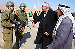 A Palestinian man scuffles with Israeli soldiers as he try to evacuate Jewish settlers from Palestinian land near the village of Yatta, south of the West Bank city of Hebron on Jan. 2, 2011. Photo by Najeh Hashlamoun