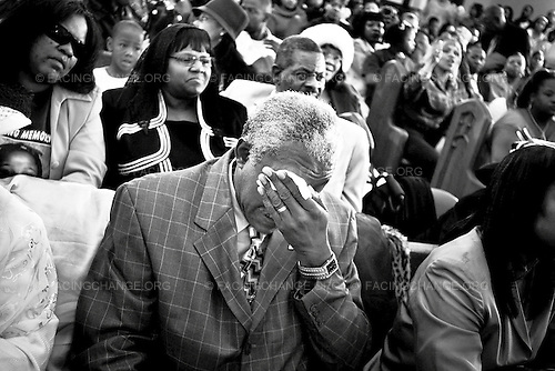 Chicago, Illinois, USA<br /> May 2007<br /> <br /> Wiping tears from his eyes at the funeral for his granddaughter, Wilbert Pointer mourns the loss of Siretha White. Siretha, a 10-year-old girl was shot and killed by a spray of bullets while attending her birthday party in Chicago's Englewood neighborhood. Eight days before another young girl,  Starkesia Reed, was killed blocks away. Over 300 people, including Siretha's classmates, teachers, church leaders, as well as the Mayor of Chicago and the Governor of Illinois attended her funeral.