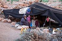 Todra Gorge, Morocco.  Amazigh Berber Family inside their Seasonal tent.