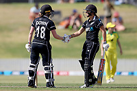 4th April 2021; Bay Oval, Taurange, New Zealand;  New Zealand's Lauren Down (L) celebrates 50 runs with team mate Amelia Kerr during the 1st women's ODI White Ferns versus Australia cricket match at Bay Oval in Tauranga.