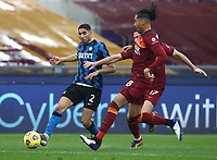 Football, Serie A: AS Roma -  FC Internazionale Milano, Olympic stadium, Rome, January 10, 2021. <br /> Inter's Achraf Hakimi (l) in action with Roma's Jordan Veretout (c) and Chris Smalling (r) during the Italian Serie A football match between Roma and Inter at Rome's Olympic stadium, on January 10, 2021.  <br /> UPDATE IMAGES PRESS/Isabella Bonotto