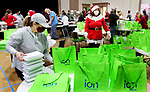 NAUGATUCK CT. - 25 December 2020-122520SV01-About 75 volunteers fill bags with Christmas dinner to be delivers to familys in need at St. Michaels Church in Naugatuck Friday.<br /> Steven Valenti Republican-American
