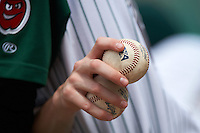 Fort Wayne TinCaps player holding two baseballs in the dugout during the second game of a doubleheader against the Great Lakes Loons on May 11, 2016 at Parkview Field in Fort Wayne, Indiana.  Great Lakes defeated Fort Wayne 5-0.  (Mike Janes/Four Seam Images)