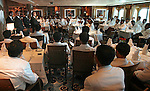 The waiters assemble before lunch for last minute instructions for the top chefs onboard the Queen Mary II.