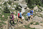 Young women hiking in the Indian Peaks Wilderness Area, west of Boulder, Colorado. Guided photo tours to Indian Peaks.