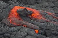 To me it looked like Yoda was being enveloped in lava.  In May 2015, the only way to reach flowing lava on the Big Island of Hawaii was by a 6 mile, round trip, walk through mud which was constant on the entire hike. Sometimes 1 inch and up to mid-calf at other times. If you go, hope for clouds or rain to make the glow more vibrant during the daytime. This hike must be done with a Hawaiian guide, not on your own. The process is to find the lava flow and wait for bulges where the lava breaks out and flows. Treat Madame Pele with respect at all times.