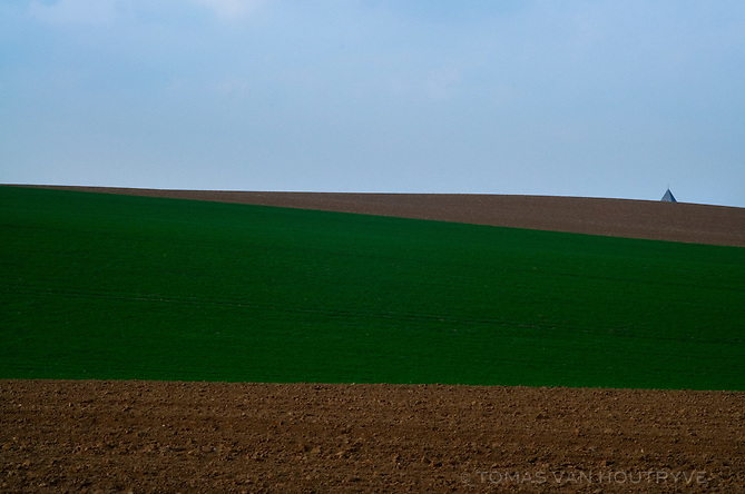 A church steeple is seen over the fields near Herstappe, Belgium on April 23, 2013.