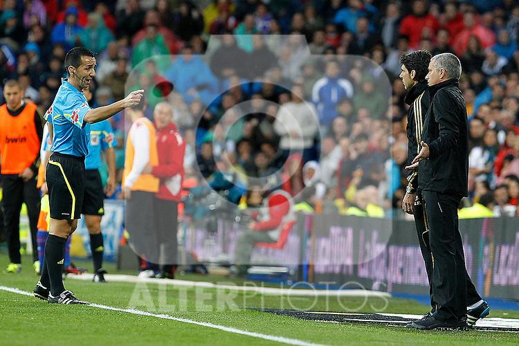 Real Madrid's coach Jose Mourinho have words with the referee Pedro Jesus Perez Montero (l) during La Liga match.April 14,2012. (ALTERPHOTOS/Acero)