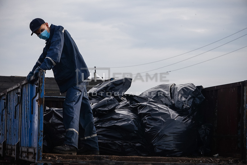 Man loads corpses of passengers of flight MH17 Malaysian Airways Boeing 777, crashed in Hrabove, Eastern Ukraine.