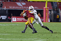 LOS ANGELES, CA - SEPTEMBER 11: Kyu Blu Kelly #17 of the Stanford Cardinal tackles K.D. Nixon #21 of the USC Trojans during a game between University of Southern California and Stanford Football at Los Angeles Memorial Coliseum on September 11, 2021 in Los Angeles, California.
