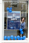 The city of Perth shows it's support for St Johnstone ahead of Saturdays Scottish Cup Final against Hibs at Hampden... 21.05.21<br />Estate agent Susan Duffy decorates the window of Aberdein Considine in Perth showing their support ahead of saturday's Scottish Cup Final against Hibs.<br />Picture by Graeme Hart.<br />Copyright Perthshire Picture Agency<br />Tel: 01738 623350  Mobile: 07990 594431