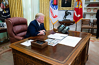 United States President Donald J. Trump, accompanied by US Attorney General William P. Barr, makes remarks before signing an executive order in the Oval Office of the White House in Washington, DC that will punish Facebook, Google and Twitter for the way they police content online, Thursday, May 28, 2020. <br /> Credit: Doug Mills / Pool via CNP/AdMedia