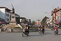Nepal, Kathmandu.  Durbar Marg Street.  Narayanhiti Royal Palace (now a museum) in background, King Mahendra Statue in foreground.