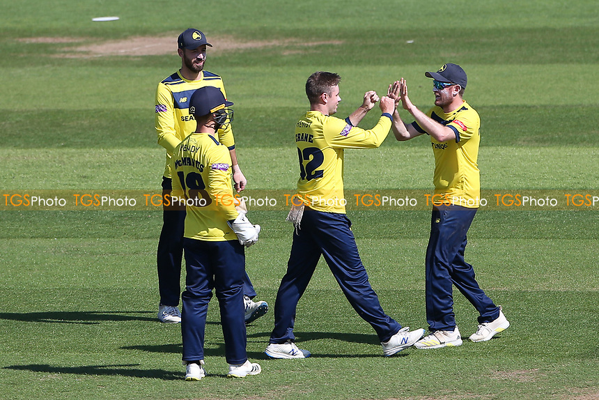Mason Crane of Hampshire celebrates with his team mates after taking the wicket of Tom Westley during Hampshire Hawks vs Essex Eagles, Vitality Blast T20 Cricket at The Ageas Bowl on 16th July 2021