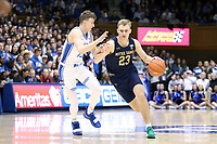 DUKE, NC - FEBRUARY 15: Dane Goodwin #23 of the University of Notre Dame drives past Alex O'Connell #15 of Duke University during a game between Notre Dame and Duke at Cameron Indoor Stadium on February 15, 2020 in Duke, North Carolina.