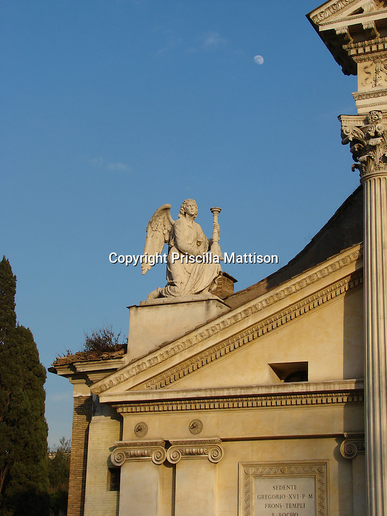 Rome, Italy - January 29, 2007:  An angel statue kneels at a corner of the Chiesa di San Rocco all' Augusteo.