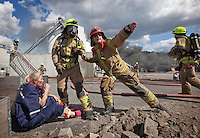 "Firefighters rescue ""victims"" and put out fire in an oil facility. HarbourEx15, a field training exercise with scenarios connected to operations in the harbor April 27th – 29th 2015.<br />