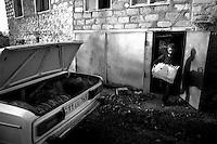 """Nagorny-Karabach, 20.05.2011, Shushi. B?cker Armen l?dt am morgen seinen Lade voll Brot und liefert es an die lokalen L?den aus. """"The Twentieth Spring"""" - ein Portrait der s¸dkaukasischen Stadt Schuschi, 20 Jahre nach der Eroberung der Stadt durch armenische K?mpfer 1992 im B¸gerkrieg um die Unabh?ngigkeit Nagorny-Karabachs (1991-1994). In the early morning baker Armen load his car full of bread and delivers it to local shops in Shushi. """"The Twentieth Spring"""" - A portrait of Shushi, a south caucasian town 20 years after its """"Liberation"""" by armenian fighters during the civil war for independence of Nagorny-Karabakh (1991-1994). .En début de matinée un boulanger arménien charge de sa voiture  de pain et le livre au commerce de proximité à Chouchi.""""Le Vingtieme Anniversaire"""" - Un portrait de Chouchi, une ville du Caucase du Sud 20 ans après sa «libération» par les combattants arméniens pendant la guerre civile pour l'indépendance du Haut-Karabakh (1991-1994)..© Timo Vogt/Est&Ost, NO MODEL RELEASE !!"""