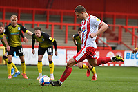 Luke Norris of Stevenage FC scores the third goal from the spot  during Stevenage vs Barrow, Sky Bet EFL League 2 Football at the Lamex Stadium on 27th March 2021
