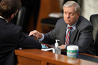 United States Senator Lindsey Graham (Republican of South  Carolina), Chairman, US Senate Judiciary Committee speaks to US Senator Ben Sasse (Republican of Nebraska) before a  business meeting prior to the fourth day for the confirmation hearing of President Donald Trump's Supreme Court nominee Judge Amy Coney Barrett on Thursday, October 15, 2020.<br /> Credit: Greg Nash / Pool via CNP /MediaPunch