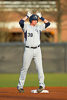 TD Davis (38) of the Georgia Southern Eagles gives the deer antlers sign to his teammates after hitting a double against the UNCG Spartans at UNCG Baseball Stadium on March 29, 2013 in Greensboro, North Carolina.  The Spartans defeated the Eagles 5-4.  (Brian Westerholt/Four Seam Images)