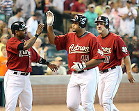 Astros Miguel Tejada, Carlos Lee, and Lance Berkman following Lee's 3 run HR against the Phillies on Sunday May 25th at Minute Maid Park in Houston, Texas. Photo by Andrew Woolley / Four Seam Images.