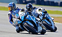 Larry Pegram (72) leads another rider during the AMA SuperBike motorcycle race at Daytona International Speedway, Daytona Beach, FL, March 2011.(Photo by Brian Cleary/www.bcpix.com)