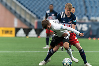 FOXBOROUGH, UNITED STATES - MAY 28: Josh Penn #16 of Fort Lauderdale CF attempts to control the ball as Sean O'Hearn #40 of New England Revolution II defends during a game between Fort Lauderdale CF and New England Revolution II at Gillette Stadium on May 28, 2021 in Foxborough, Massachusetts.