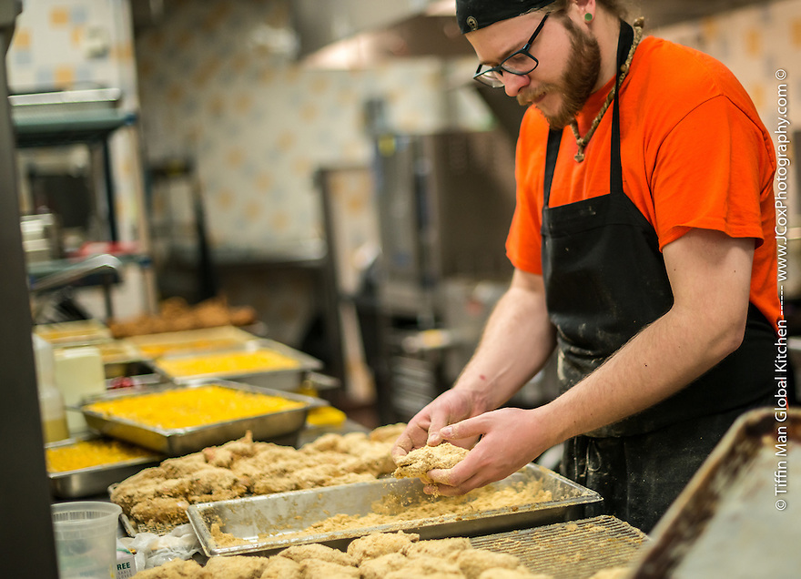 staff at Tiffin Man Global Kitchen prepare the catering entrees for the guests of an event at Minneapolis Community and Technical College. All food served is homemade from scratch every day at Tiffin Man, at the cafeteria inside the college.