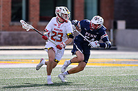 College Park, MD - February 15, 2020: Maryland Terrapins midfielder Kyle Long (23) runs past Penn Quakers midfielder Piper Bond (54) during the game between Penn and Maryland at  Capital One Field at Maryland Stadium in College Park, MD.  (Photo by Elliott Brown/Media Images International)