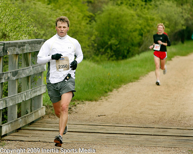 DEADWOOD, SD - JUNE 7, 2009 :  Tom Waage approaches the Englewood Trailhead early in the half-marathon during the Deadwood Mickelson Trail Marathon and half-marathon Sunday. (Photo by Dick Carlson/Inertia)