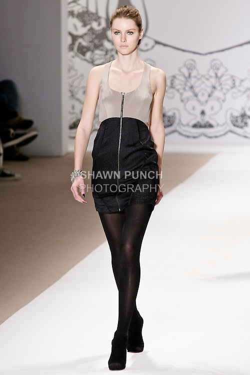 Elena walks the runway in a dahlia sleeveless exposed zipper front dress with cutout back detail in parchment/black, and cap cubes bracelet, by Wenlan Chia, for the Twinkle By Welan Fall 2010 fashion show, during Mercedes-Benz Fashion Week Fall 2010.