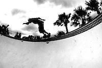 Daniel Berry rides the rail of the empty pool at the YMCA skate park in West Palm Beach.<br /> (Photo by Courtney Harris)