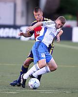 Chris Wingert and Ronnie O'Brien in the 0-0 draw at Rice Eccles Stadium in Salt Lake City, Utah on June 18, 2008.