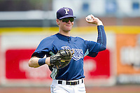 John Alexander (23) of the Princeton Rays warms up in the outfield prior to the game against the Burlington Royals at Hunnicutt Field on July 15, 2012 in Princeton, West Virginia.  The Royals defeated the Rays 2-0 in game one of a double header.  (Brian Westerholt/Four Seam Images)