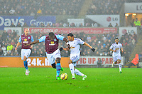 Pictured: Friday 26 December 2014<br /> Re: Premier League, Swansea City FC v Aston Villa at the Liberty Stadium, Swansea, south Wales, UK.<br /> <br /> Swansea's Jefferson Montero chasing down Jores Okore