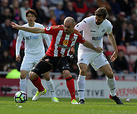 SUNDERLAND, ENGLAND - MAY 13: (L-R) Darron Gibson of Sunderland is challenged by Fernando Llorente of Swansea City during the Premier League match between Sunderland and Swansea City at the Stadium of Light, Sunderland, England, UK. Saturday 13 May 2017