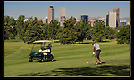 Man golfing at City Park Golf Course near downtown Denver.<br />