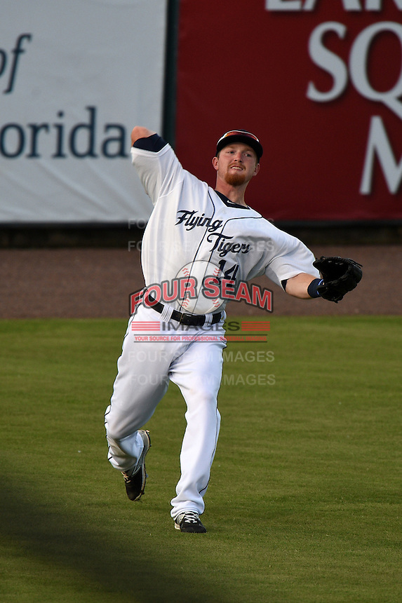Lakeland Flying Tigers outfielder Raph Rhymes (14) throws the ball in after catching a fly ball during a game against the Tampa Yankees on April 9, 2015 at Joker Marchant Stadium in Lakeland, Florida.  Tampa defeated Lakeland 2-0.  (Mike Janes/Four Seam Images)