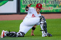 Wisconsin Timber Rattlers catcher Mario Feliciano (4) waves to a fan game one of a Midwest League doubleheader against the Kane County Cougars on June 23, 2017 at Fox Cities Stadium in Appleton, Wisconsin.  Kane County defeated Wisconsin 4-3. (Brad Krause/Four Seam Images)