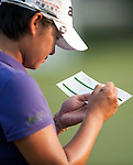TAOYUAN, TAIWAN - OCTOBER 26:  Yani Tseng of Taiwan writes her scores card on the 18th hole during the day two of the Sunrise LPGA Taiwan Championship at the Sunrise Golf Course on October 26, 2012 in Taoyuan, Taiwan. Photo by Victor Fraile / The Power of Sport Images