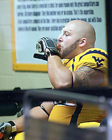 SVU nose tackle Chris Neild gets a drink at halftime. The West Virginia Mountaineers defeated the South Florida Bulls 20-6 on October 14, 2010 at Mountaineer Field, Morgantown, West Virginia.